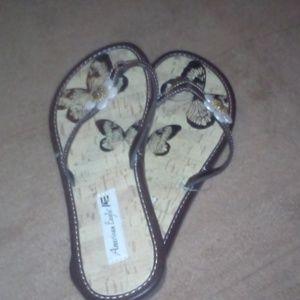 American Eagle flip flops butterfly